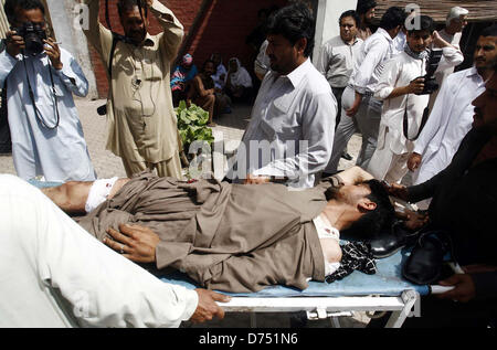 Victims of suicidal bomb explosion at University road near Azam Tower being shifted at local hospital for treatment, - Stock Photo