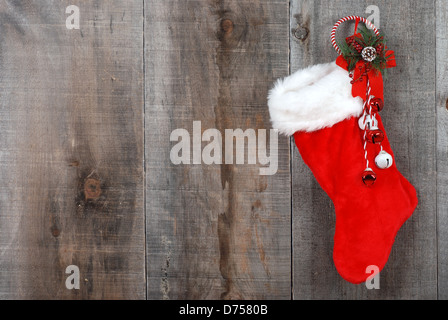Christmas sock and wreath on wood - Stock Photo