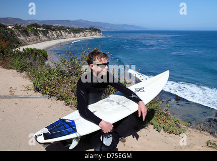 Surfer at Point Dume State Reserve in Malibu - Stock Photo