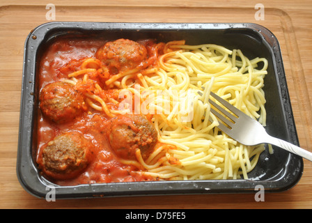 Eating a Spaghetti and Meatball TV Dinner - Stock Photo