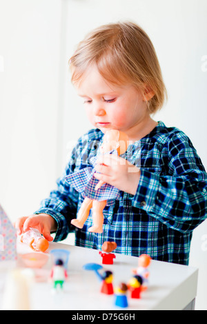 24 month old baby girl playing. - Stock Photo