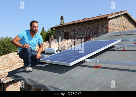 Torre Alfina, Italy, installing a solar power system on the roof of a detached house