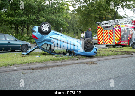 Atmosphere an allegedly stolen car crashed today on the outskirts of Manchester, where according to an eyewitness, - Stock Photo