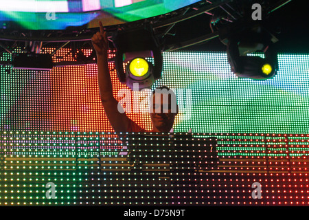 Dutch musician DJ Tiesto performs during a live event in the Spanish Balearic island of Ibiza. - Stock Photo
