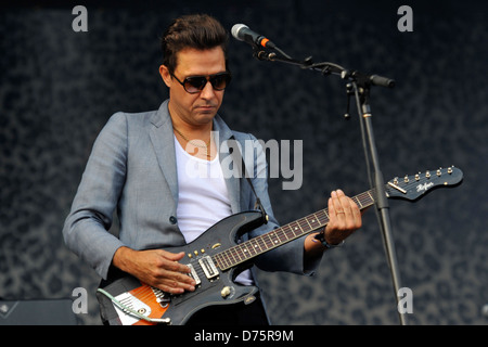 Jamie Hince of The Kills, with his wedding band visible on his left hand Lollapalooza Music Festival 2011 - Performances - Stock Photo