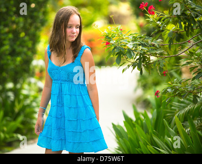 Teen-girl in the spring garden. - Stock Photo