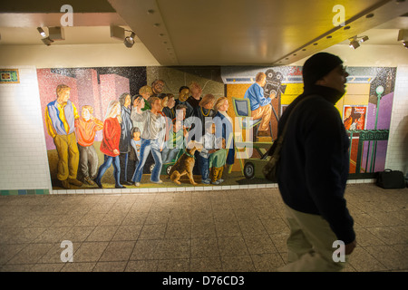 A commuter passes 'The Return of Spring/ The Onset of Winter, 2001/2005 by Jack Beal in the Times Square station - Stock Photo