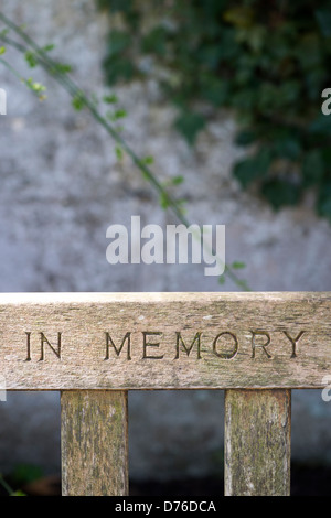 In Memory carved in a garden bench - Stock Photo