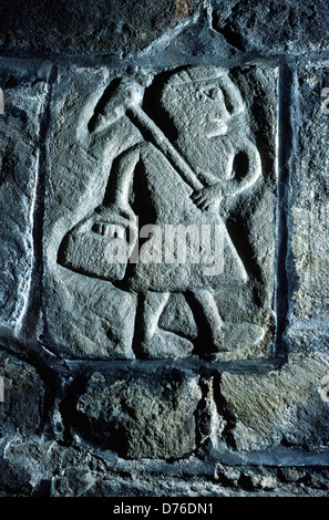 Medieval stone carving of local coal miner inside St. Mary's Church, Wirksworth, Derbyshire, England - Stock Photo
