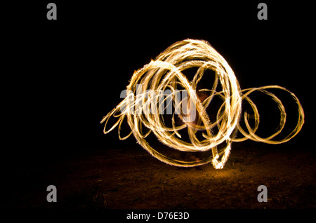 glowing spark spirals - Stock Photo