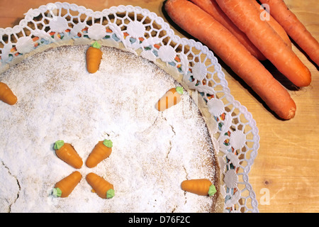 Close up of Carrot cake with marzipan carrots - Stock Photo