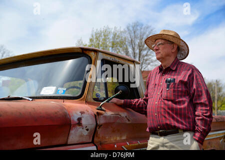 Floral Park, New York, U.S. April 28, 2013. PAUL GRAMLICH is standing next his red and white 1964 Chevrolet C-10 - Stock Photo