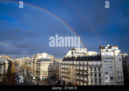 Boulevard Haussmann  skyline with rainbow against dark blue sky Paris France EU - Stock Photo