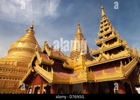 Stupas of the Shwezigon Pagoda in Bagan, Myanmar - Stock Photo