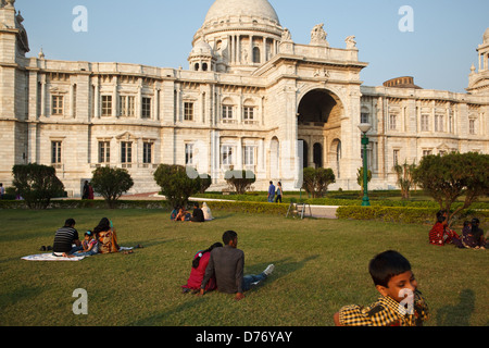 People on the lawn in front of Victoria Memorial in Kolkata, India. - Stock Photo