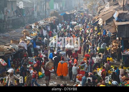 Colorful flower market at Mullick ghat near Howrah Bridge in Kolkata, India. - Stock Photo
