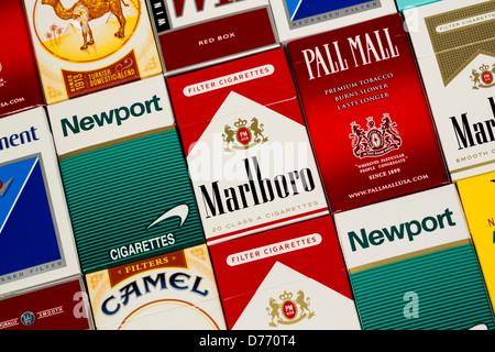 Various packs of cigarettes. Marlboro, Pall Mall, Winston, Camel, Parliament, Newport, American Spirit.