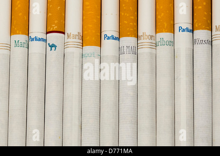Various loose cigarettes. Marlboro, Pall Mall, Winston, Camel, Parliament, Newport, American Spirit.  - Stock Photo