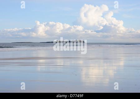 The Farne Islands from Bamburgh beach - Stock Photo