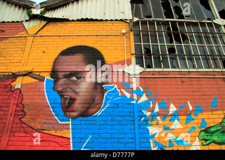 Street art on the wall of a derelict warehouse, Lisbon, Portugal - Stock Photo