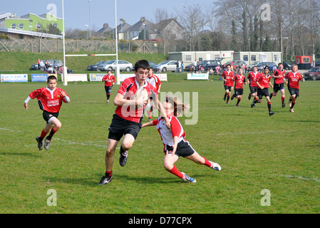 Teenage boys playing rugby, UK - Stock Photo