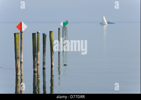 Katamaran speed boat passing sailing boat, Immenstaad Lake Constance Baden-Württemberg Germany - Stock Photo