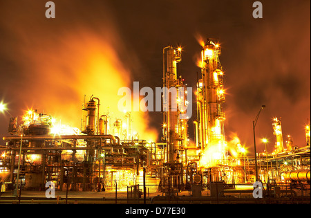 Night view fluid catalytic cracking unit at petroleum processing facility Pasadena Houston Texas USA - Stock Photo