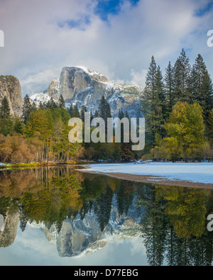 Yosemite National Park, CA: Half Dome (8842 ft) reflected in the Merced River after a snowfall - Stock Photo