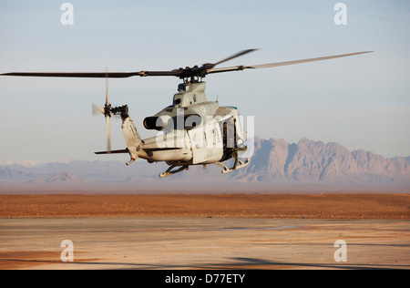 United States Marine Corps UH-1Y Venom helicopter launches on combat operation in Helmand Province Afghanistan - Stock Photo