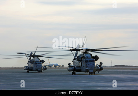 Two United States Marine Corps CH-53E Super Stallion helicopters refuel prepare to launch into skies on mission - Stock Photo