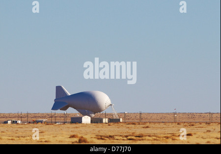 TARS or Tethered Aerostat Radar System low-altitude surveillance system that uses aerostat tethered balloon as radar - Stock Photo