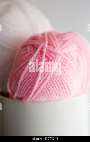Two balls of wool placed in a tin - Stock Photo