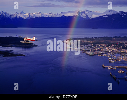 Alaska Island Air de Havilland Beaver flying over Wrangell Narrows rainbow above Petersburg Alaska. - Stock Photo