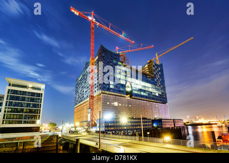 The Elbphilharmonie located under construction in the harbour city of Hamburg, Germany, Europe - Stock Photo
