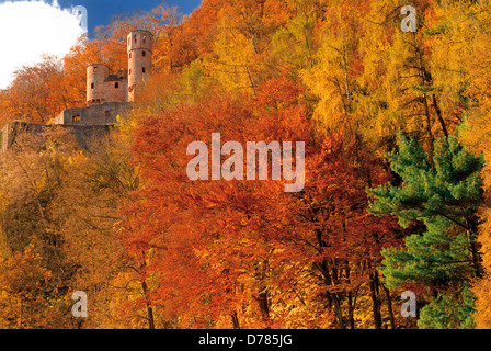 Germany, Hessen: Medieval castle 'Schadeck' surrounded by autumn forest in Neckarsteinach - Stock Photo