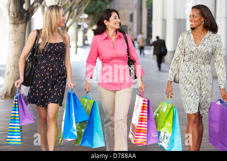 Group Of Friends Carrying Shopping Bags On City Street Stock Photo ...