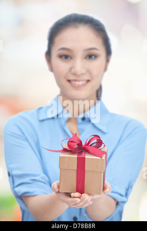 Young Woman Holding Gift Box - Stock Photo