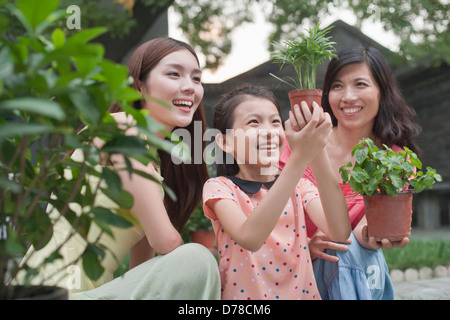 Two Women and Young Girl Gardening - Stock Photo