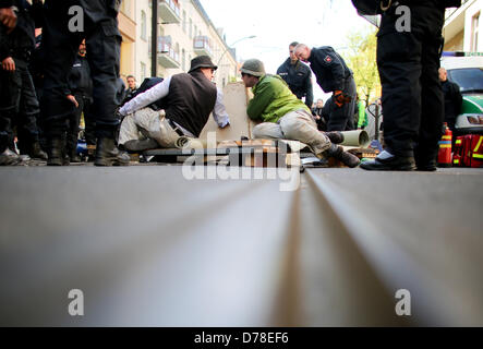 Chained to a pyramid made of concrete activists block the street prior to a rally of the extreme right-wing NPD - Stock Photo