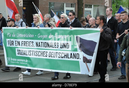 Supporters of the extreme right-wing NPD rally in Schoeneweide district in Berlin, Germany, 01 May 2013. Photo: - Stock Photo