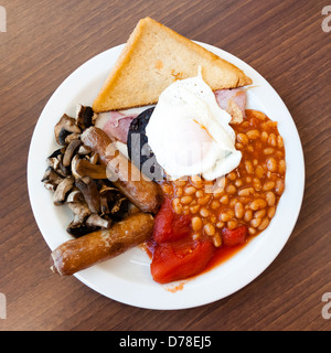 Full English breakfast, with black pudding fry up at a cafe. Fried breakfast overhead food UK. - Stock Photo
