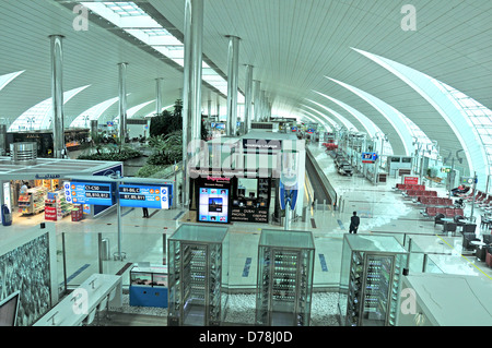 departure hall terminal 3 Dubai international airport - Stock Photo