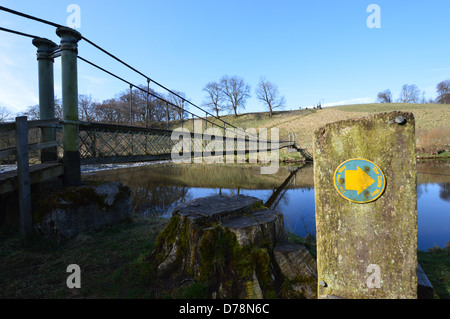 The Suspension Bridge over the River  Wharfe near Hebden on the Dales Way Long Distance Footpath Yorkshire - Stock Photo