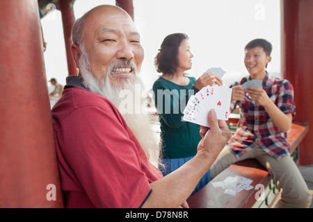 Chinese Family Playing Card In Jing Shan Park - Stock Photo