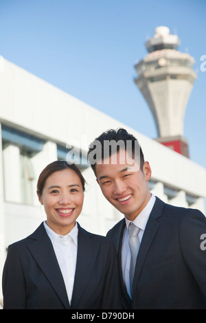 Two travelers portrait at airport - Stock Photo