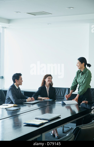 Co-workers in meeting room - Stock Photo