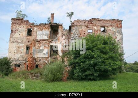 Damaged buildings in Croatia, after the Balkan war in ex-Yougoslavia - Stock Photo