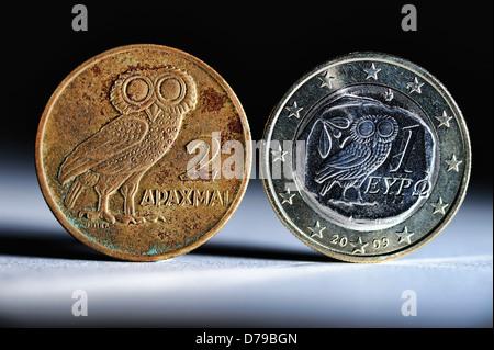 Greek drachm and Greek euro-coin one , Griechische Drachme und griechische Ein-Euro-Münze - Stock Photo