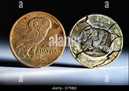 Greek drachm and Greek euro-coin one with tears , Griechische Drachme und griechische Ein-Euro-Münze mit Rissen - Stock Photo