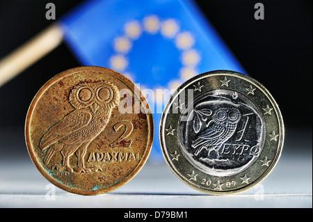 Greek drachm, Greek euro-coin one and EU flag , Griechische Drachme, griechische Ein-Euro-Münze und EU-Fahne - Stock Photo